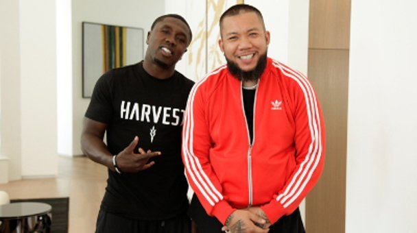 Relaxed two shot JC tha Barber and boxer Andre Berto