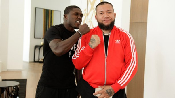 Two shot Andre Berto and JC the Barber with fists up