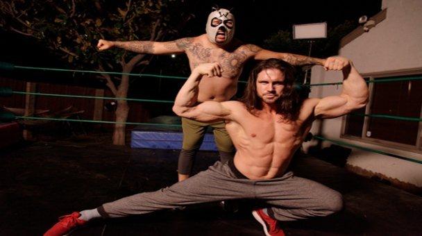 John Hennigan AKA Johnny Nitro AKA Johnny Bravo poses with masked wrestler