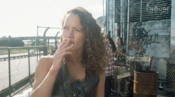 Beth smokes cigarette