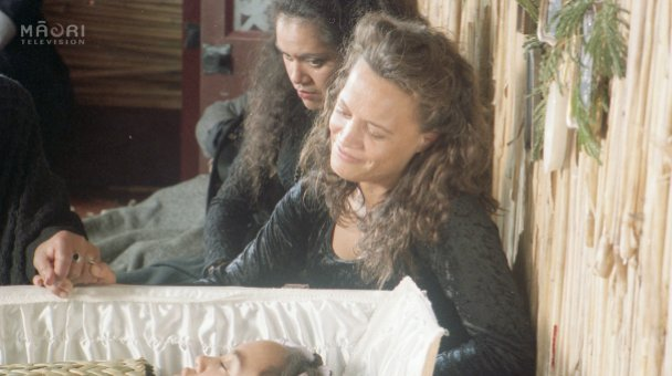 Beth seated beside Gracie's coffin