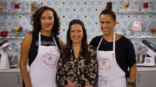 Ria Kahurangi and Kylie smiling for the camera in the Whānau Bake Off kitchen
