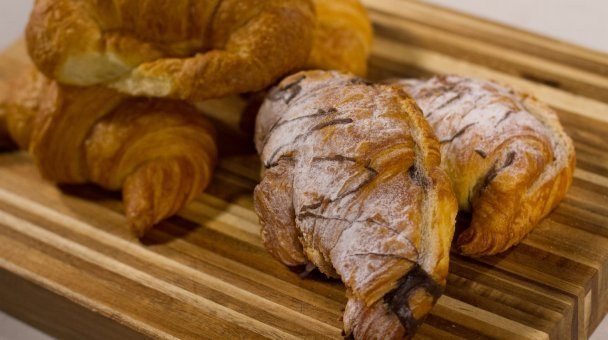 Freshly baked pastries displayed on a wooden board