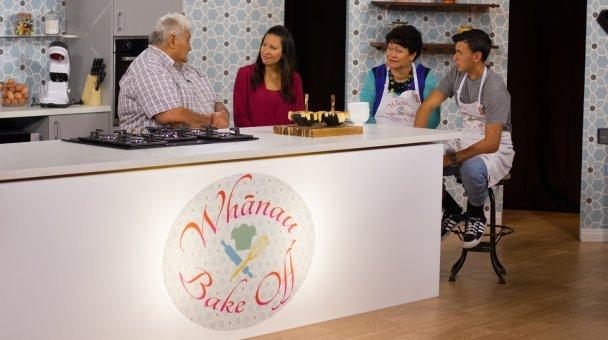 Group shot Gundy, Kahurangi, Piki, and Niko seated in the Whānau Bake-Off kitchen talking