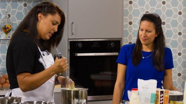Kahurangi Maxwell watches Heather stirring her mixture.