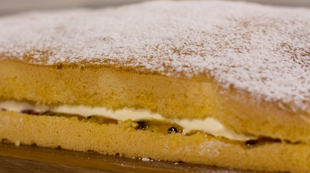 Cooked cream filled sponge on the bench