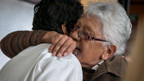 CU kuia hugging person