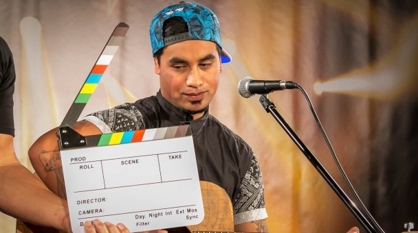 Slate board in front of young man auditioning