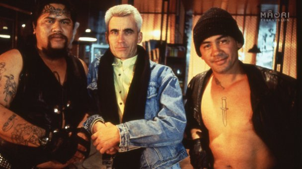 Lee poses with gang members