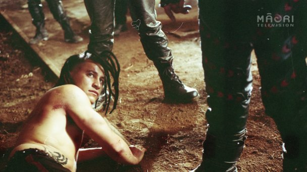Nig lying on the ground beaten at gang initiation
