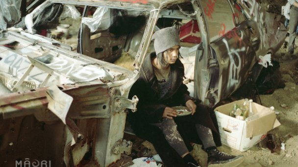 Toots seated in car wreck