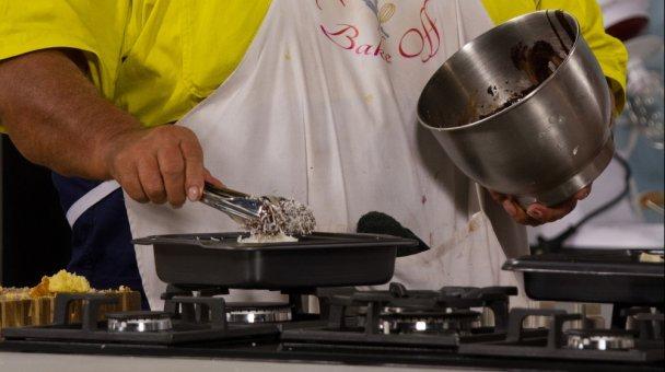 Hands mixing ingrediants
