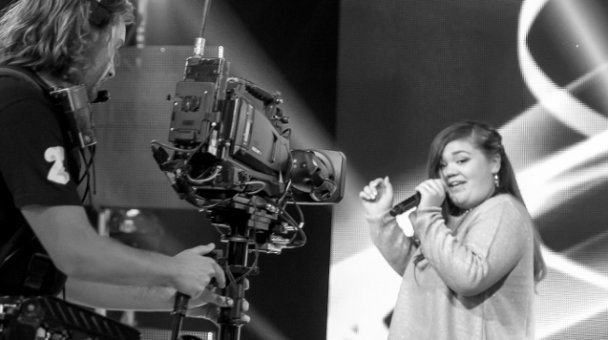 Female contestant performs on stage - cameraman in shot