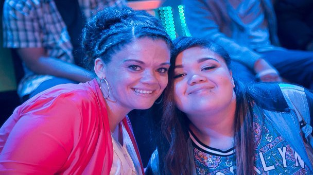 Two female contestants smile for the camera