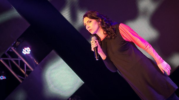 Female contestant on stage singing