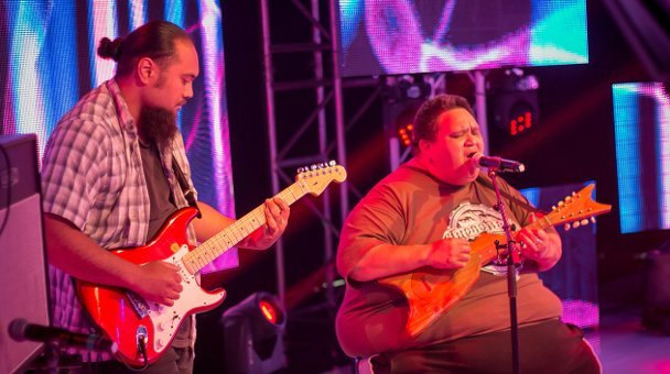 Two males on stage performing