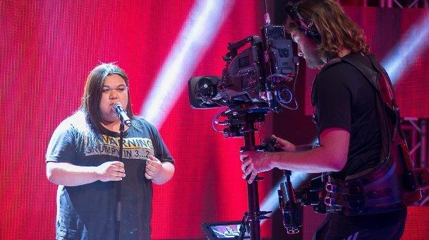 Female contestant singing cameraman in shot