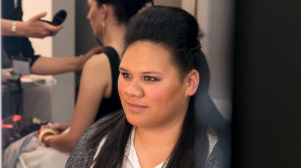 Female contestant MCU in make up room