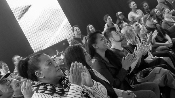 Black & white photo of audience watching the show