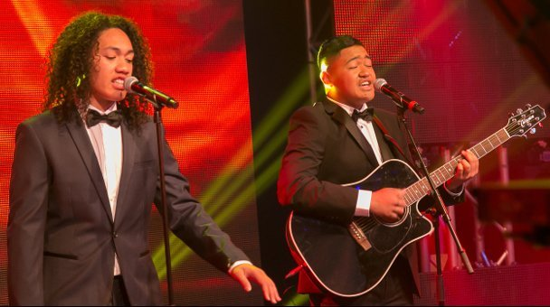 Two male contestants on stage performing