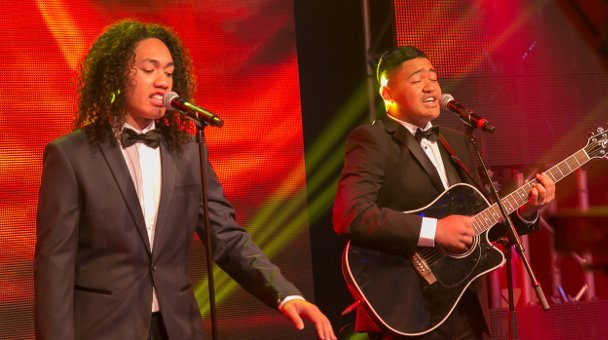Two suave males performing on stage