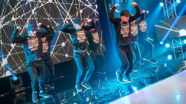 Male group identity perform on stage