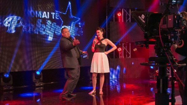 Brent Mio on stage with female performer - camera in shot