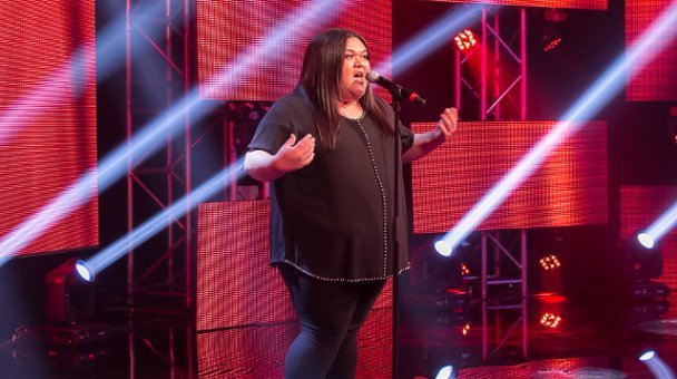 Female contestant on stage performing