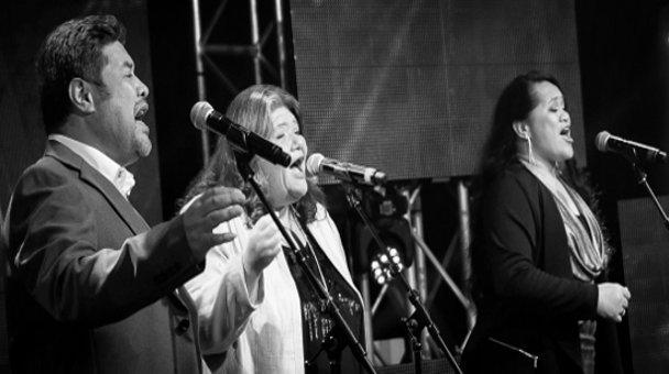 Black & white photo - contestants on stage singing