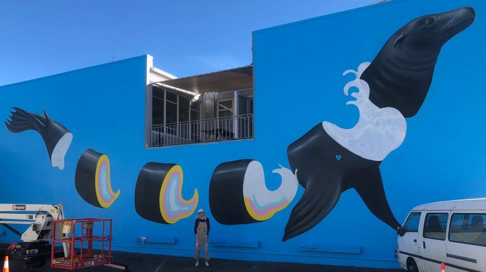 Artist Gina Kiel with her 'Seal' mural