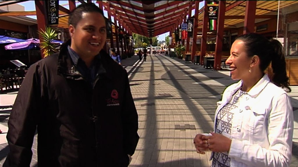 Rawiri and Kahurangi standing talking in the township of Rotorua