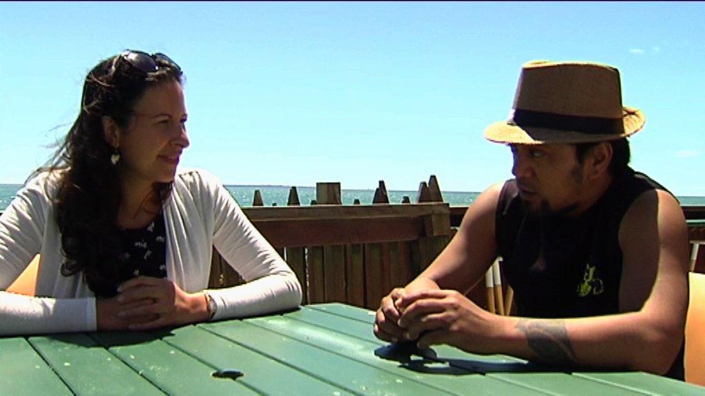 Waata and Kahurangi seated on picnic table talking