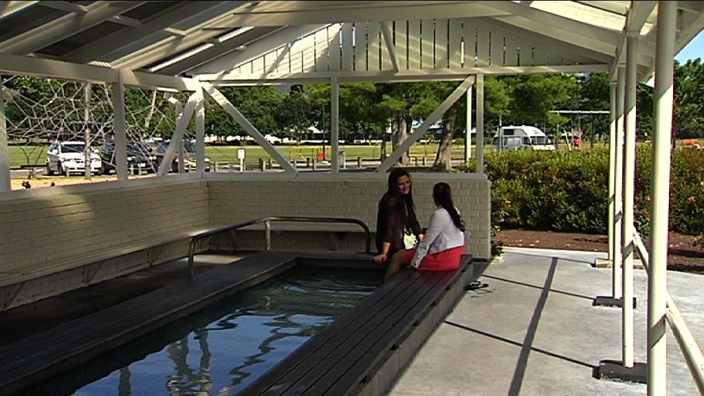 Mercia and Kahurangi seated poolside - Kuirau Park Rotorua
