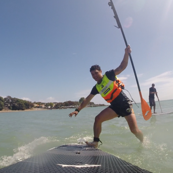 Rereahu falling off Stand Up Paddleboard on the ocean