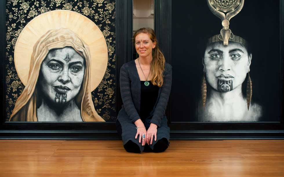 "Artist Sofia Minson with her paintings ""Rose of the Cross"" and ""Queen of Raa"""