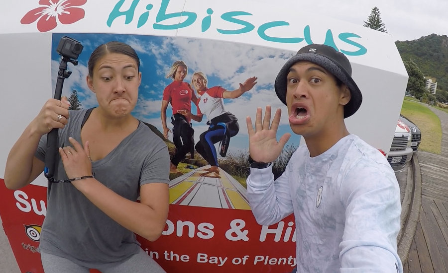 Reareahu and Waioira SELFIE in front of a Hibiscus Surfing sign