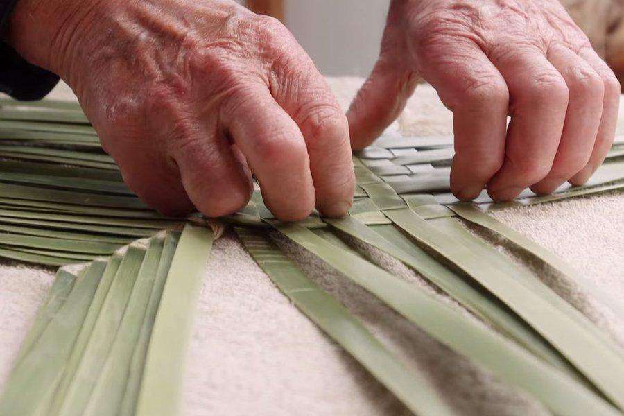 Hands weaving harakeke (flax)
