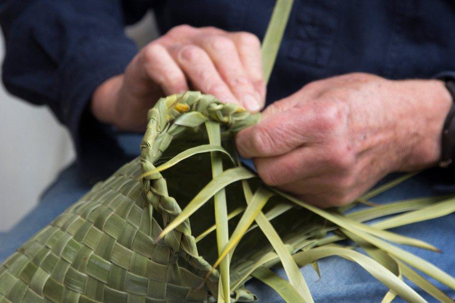 Hands weaving Pōhā