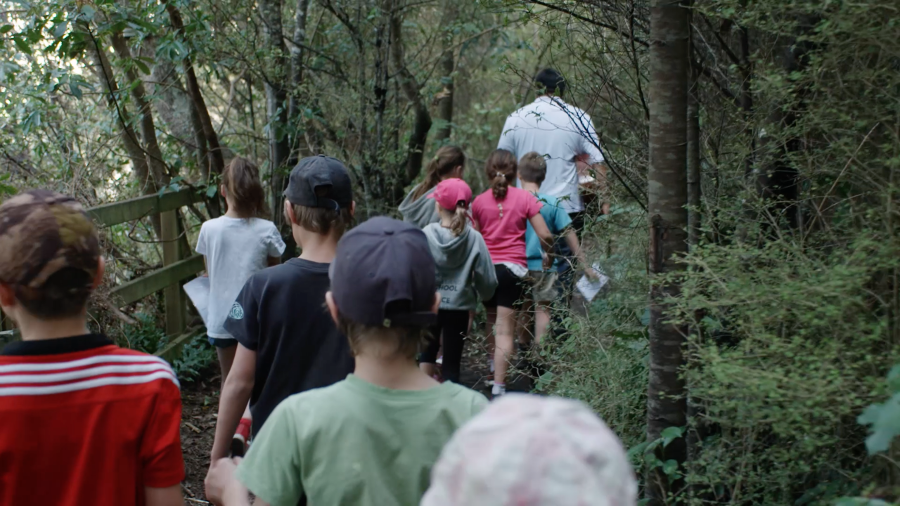 Maurice Manawatu leads school group through the forest