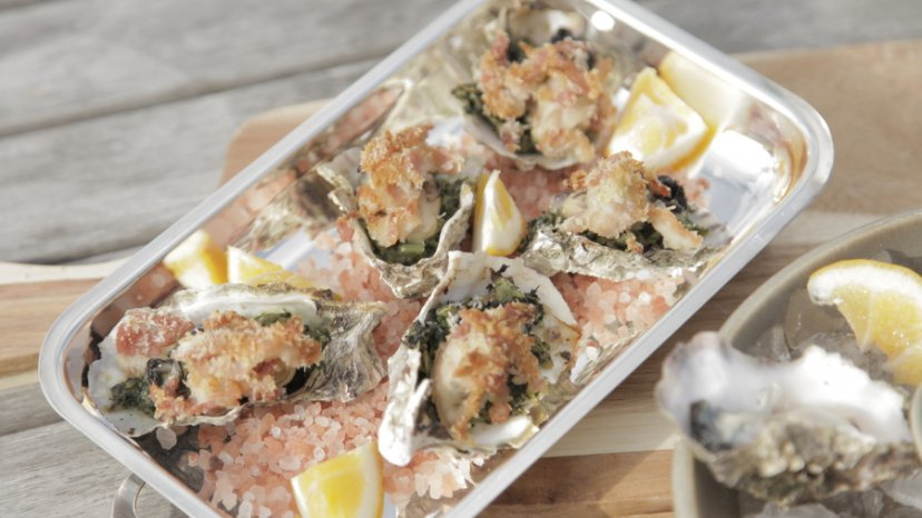 Oysters Rockafella presented in a rectangle bowl set on table