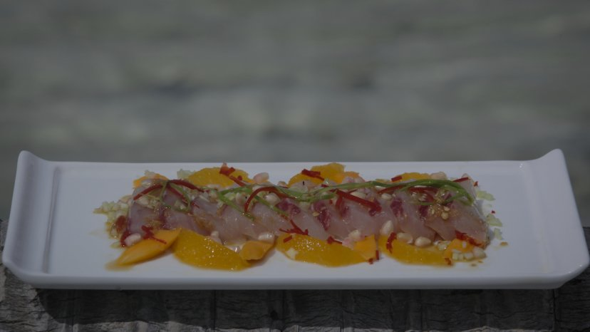 Raw Trevally Salad with Pomegranate on display