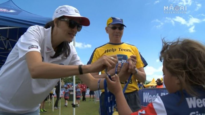One young student receiving her Weet-Bix TRYathlon medal