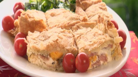 Bacon & Egg pie presented on a wooden board