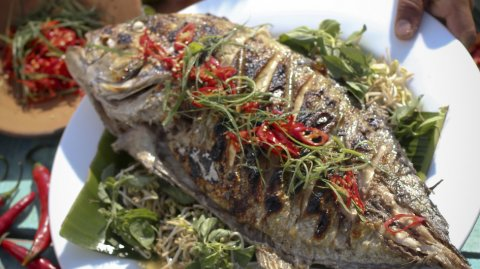Barbecued Trevally with Sambal Bajak Makassar presented on a plate
