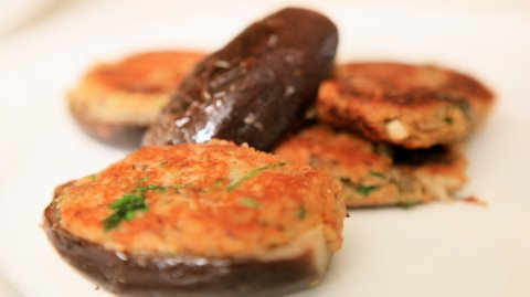 Melanzane Ripiene (Stuffed Eggplant) presented on a plate