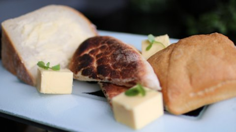 three different breads presented on a serving platter