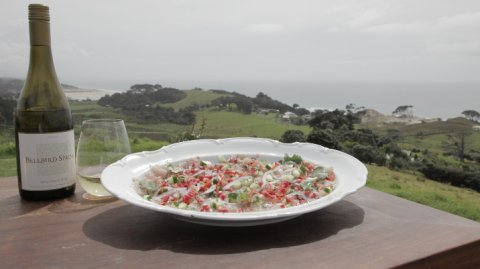 Kingfish Ika Mata presented in a bowl with a bottle of wine on the side
