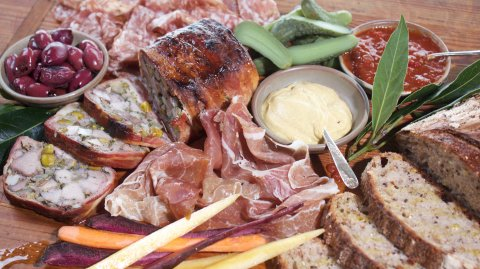Charcuterie Platter of Pork with Rustic Pork Terrine on display