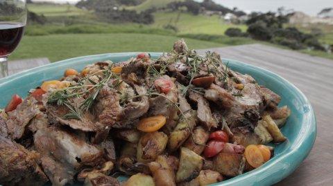 Boned Leg of Lamb with Honey Apricot Herb Stuffing, Roast Root Vegetables & Pan Gravy on display