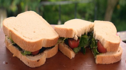 Marmite sandwhiches presented on a wooden board